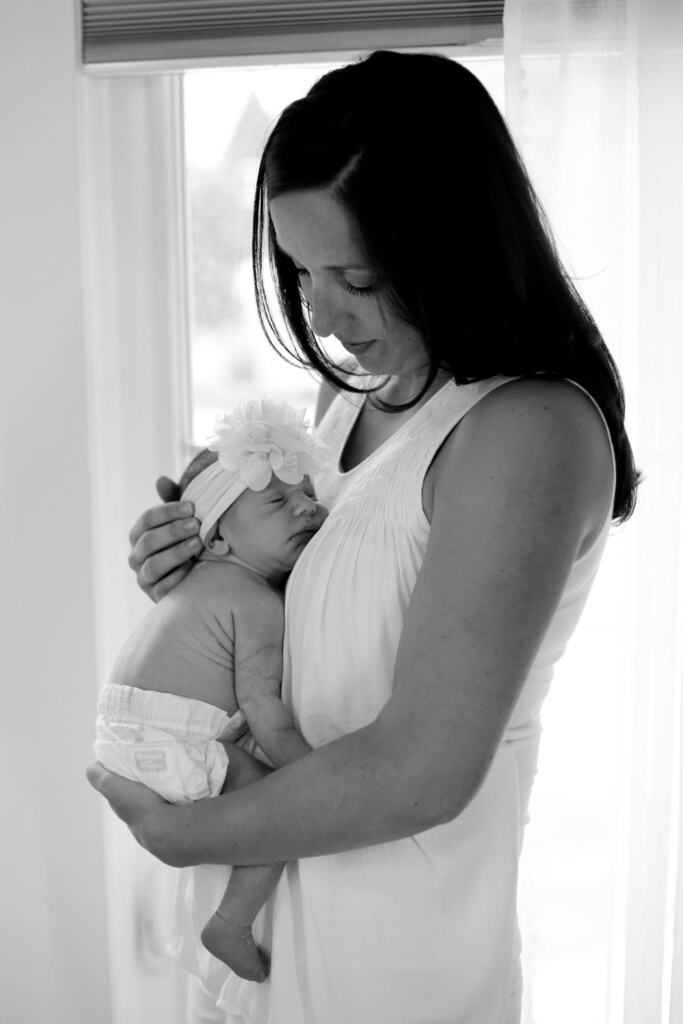 Just so you see I haven't totally let myself go, here's a sneak peak at one of the photos from Lily's newborn photo session! I'm showered, hair is done, makeup is on! But sweet Lily still looks 1,000 times better. I hope to share more family photos from the session soon!