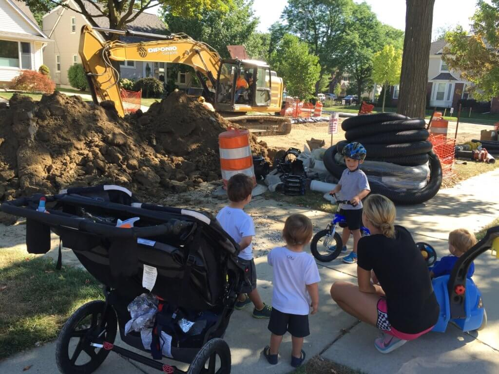 And when we have our fill of the park, we watch construction with friends! Not pictured: sweat-soaked Mom and sleepy Lily [in the carrier].