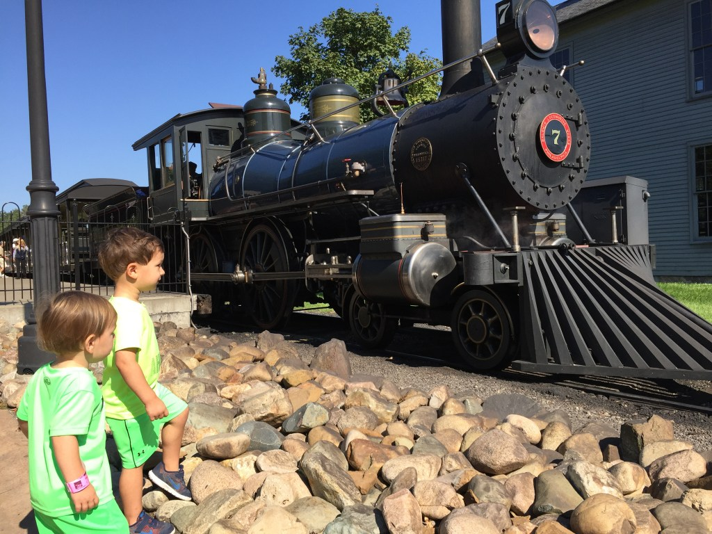 Hanging with his best bud doing their thing... walking and talking about trains!