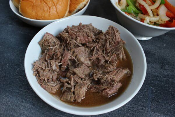 French Dip Sandwiches get a healthy makeover with extra veggies and a low-sodium dipping sauce. This easy-to-follow recipe is made with the help of your slow cooker!