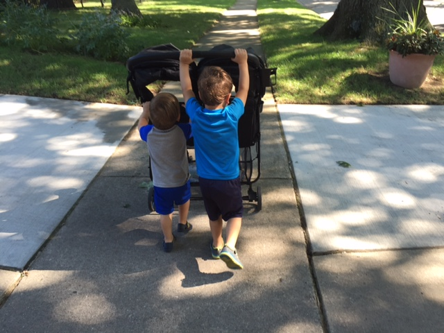 We are also into pushing the stroller vs. sitting in it. I should consider this a break on my back!