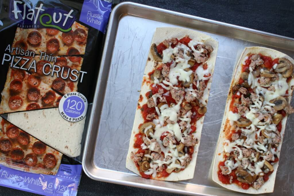 Flatbread pizza crust is topped with a homemade pizza sauce and a hearty combination of sausage, mushrooms, and onions! Making pizza night light and flavorful!