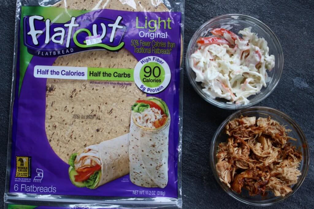 BBQ sauce and coleslaw give lots of crunch and flavor to this Flatout Flatbread BBQ chicken wrap! Perfect for a weekday lunch or simple weeknight dinner.