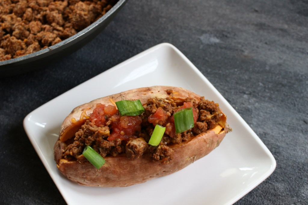 Taco stuffed sweet potatoes combine your favorite taco toppings with a nutritious sweet potato as a healthy base! Make this meal even quicker by cooking the sweet potatoes ahead of time. When it comes to weekly meal planning, we almost always have a taco-esc themed dinner night. So, whether that's oven baked tacos, taco salads, or taco stuffed sweet potatoes, I'm bringing out the lean Ground Beef, some taco seasoning, and lots of cheese. Because the boys will demand cheese melted on a mini-tortilla when they realize it's taco night! If you haven't already guessed it, these taco stuffed sweet potatoes were thoroughly enjoyed by Ted and I. The boys? Eh. Like I said, they wanted cheese melted on a tortilla [in the microwave--- so gourmet!]. Anthony had some of the beef and a few bites of my sweet potato. Joey? He definitely had his fair share of melted cheese. That doesn't mean your two or three-year-old won't like taco stuffed sweet potatoes. I'm just giving you a heads-up to have some tortillas on hand for those that want carbs from a tortilla vs. a sweet potato. Can you blame them?!