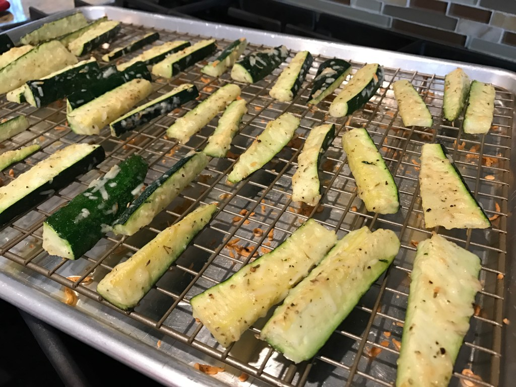 Parmesan zucchini sticks are baked to perfection and full of cheesy parmesan flavor. A simple side dish or appetizer, served best with marinara sauce for dipping.