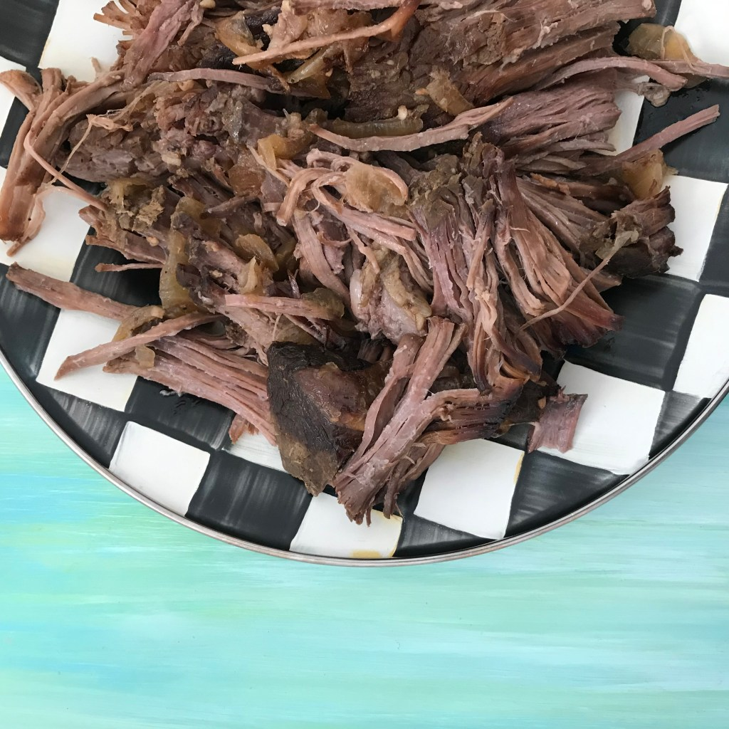 Slow Cooker Shredded Beef is the ideal cook once dine twice meal. This basic recipe can be eaten as-is, or used for multiple recipe ideas.