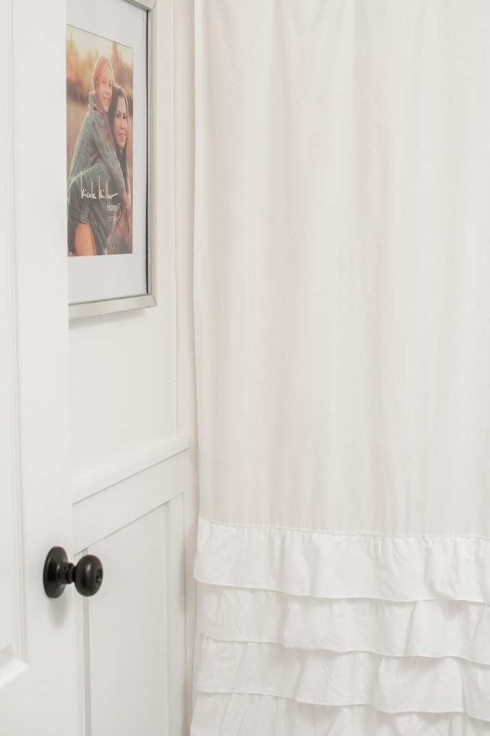 White and Bronze Bathroom Makeover; Ruffle Shower Curtain