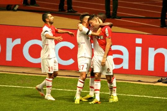 Ocampos congratulated by his teammates