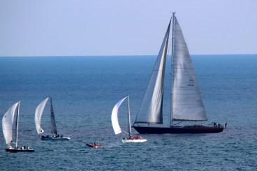 Melges 20 sailing by a larger boat @CelinaLafuenteDeLavotha