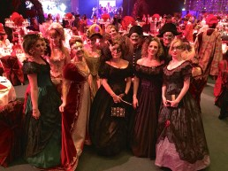 Guests of the Monaco Tourist Office surrounding Guillaume Rose at the Grand Masked Ball of Venice in Monte-Carlo
