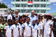 Prince Albert, Father Pedro Opeka and Donatella Campioni with the children of the School Prince Jacques and Princess Gabriella of Monaco in Madagascar @MAP