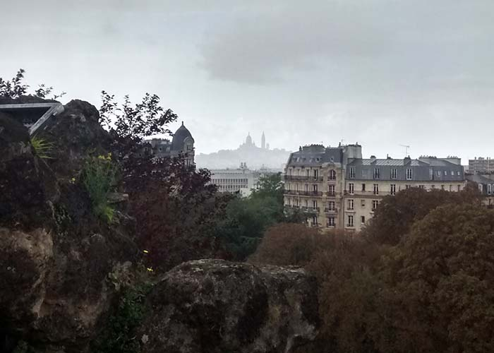 parc des buttes chaumont view of montmartre