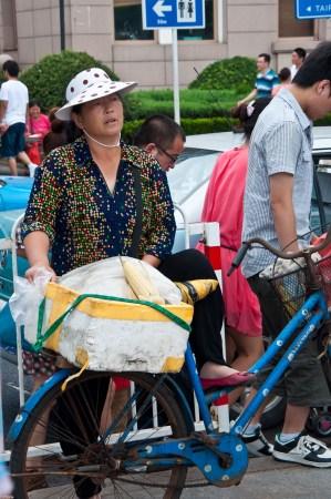 Qingdau: She was working so hard to sell her ears of corn.