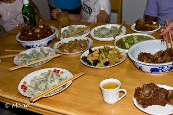 You can see the plates of finished dumplings with the other delicious dishes. The women waited until we were finished before sitting down to eat.