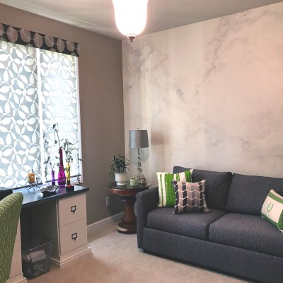 Fantasy marble accent wall in Home Office. Done in neutrals, grays, and hints of purple.