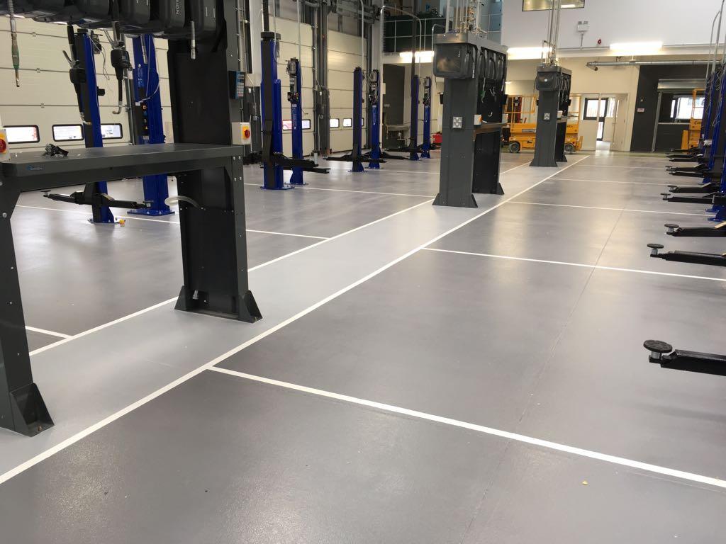 resin flooring in car workshop in croydon