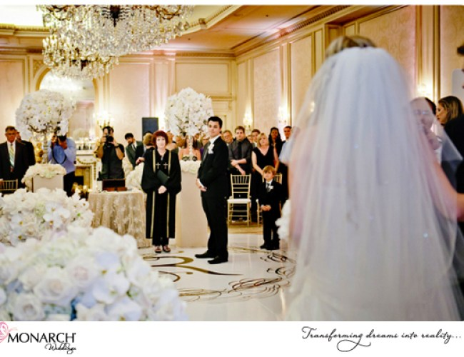 Bride-coming-down-aisle-french-vintage-wedding-westgate-hotel