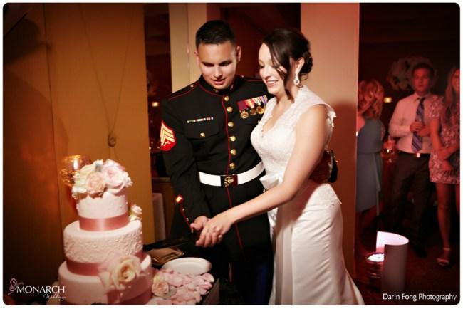 Blush-black-white-wedding-at-La-Valencia-Cake-cutting-military-knife