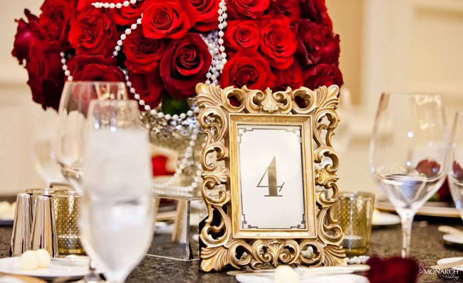 Gold-table-number-frame-red-rose-centerpiece-gatsby-theme-wedding