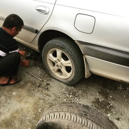 It's not a road trip across Naryn Oblast without a flat tyre!