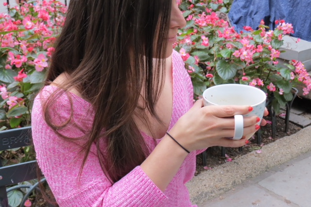 pink sweater coffee cup