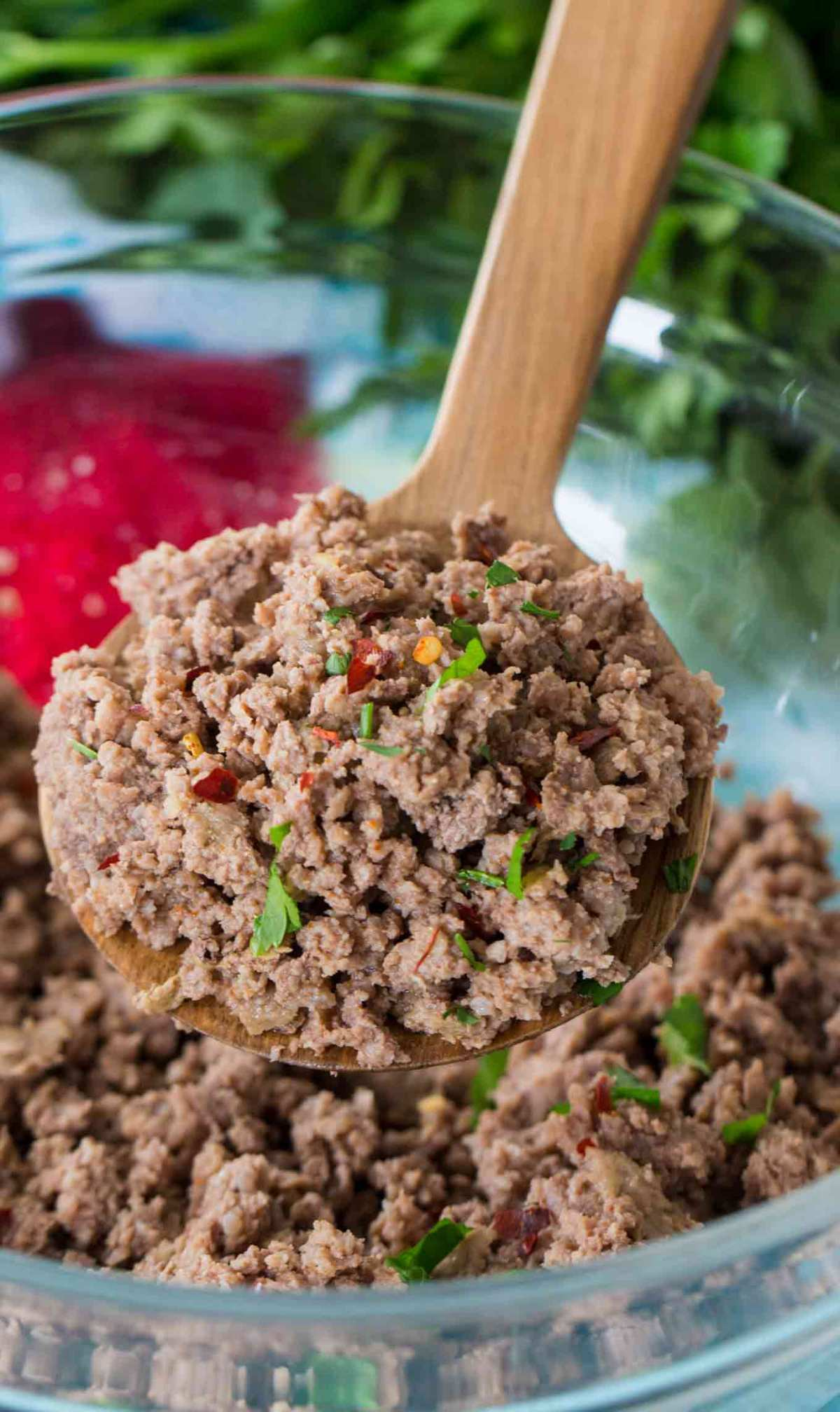 cooked seasoned ground beef in a bowl with wooden spoon