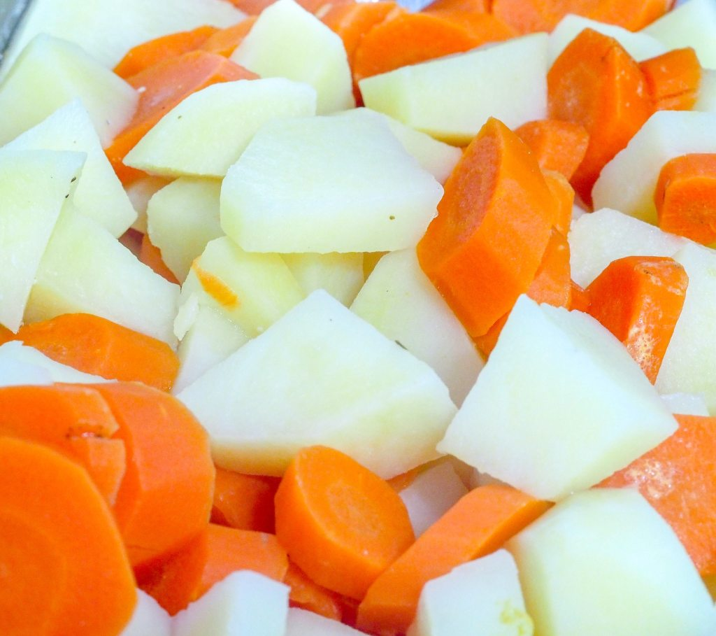 peeled and diced potatoes and carrots in a saucepan