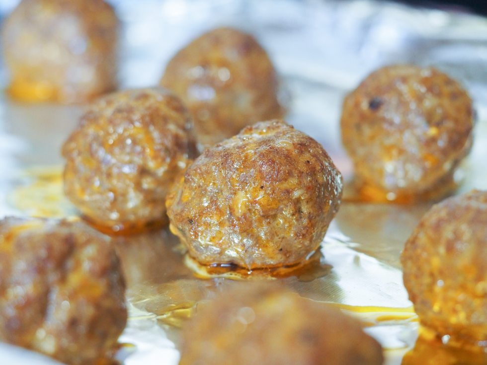 close view of broiled meatballs