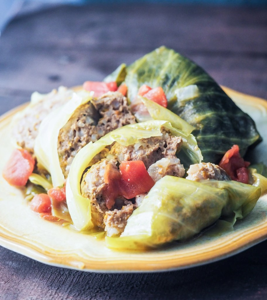 sliced stuffed cabbage rolls on yellow plate