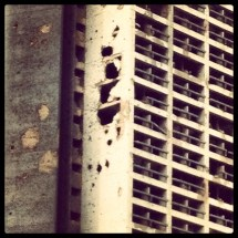 Traces of heavy shelling at the SODECO building