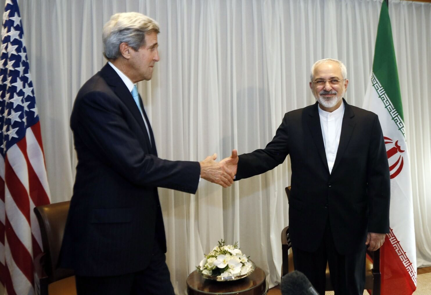 Iranian Foreign Minister Mohammad Javad Zarif (R) and U.S. State Secretary John Kerry in Geneva, January 14, 2015 . (Rick Wilking/AFP/Getty Images)