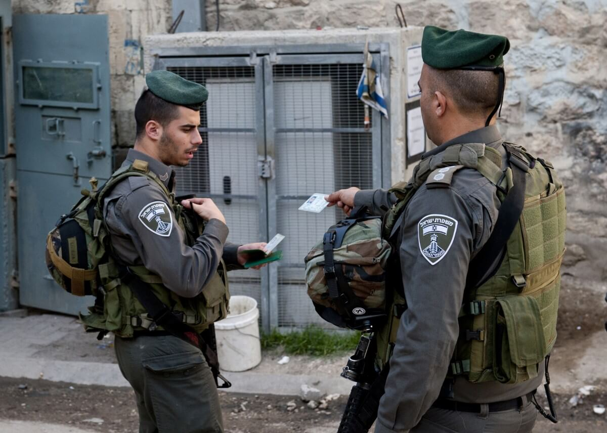 Israeli soldiers checking Palestinians' IDs. (Photo: EAPPI/P.Morgan)