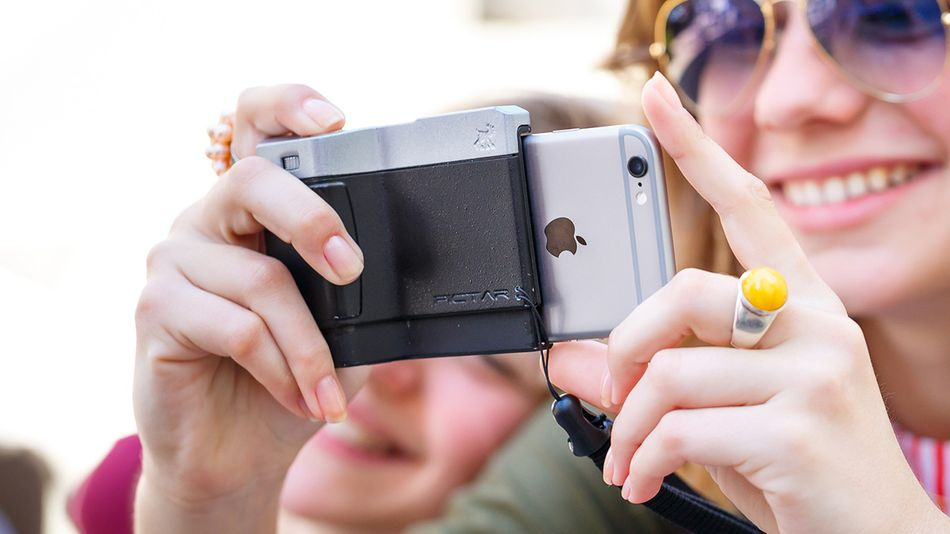 The grip pairs with a smartphone app to give you even more camera features.