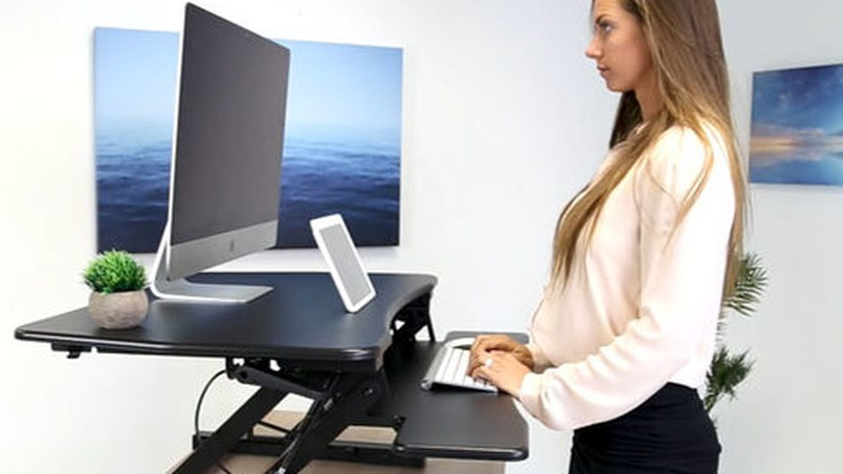 Improve your posture with this standing desk converter.