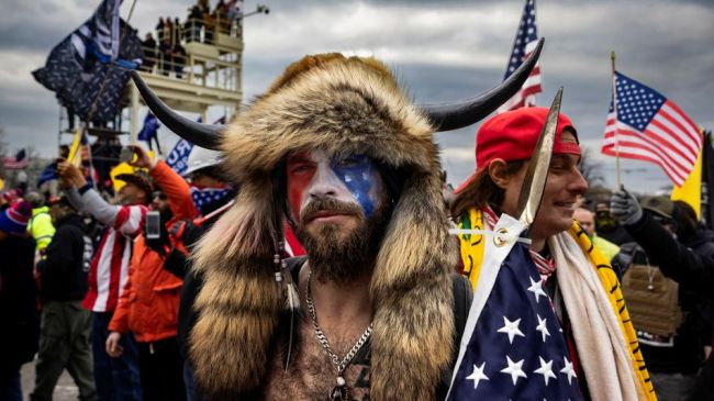 QAnon Shaman defends storming the Capitol, says he saved congressional muffins