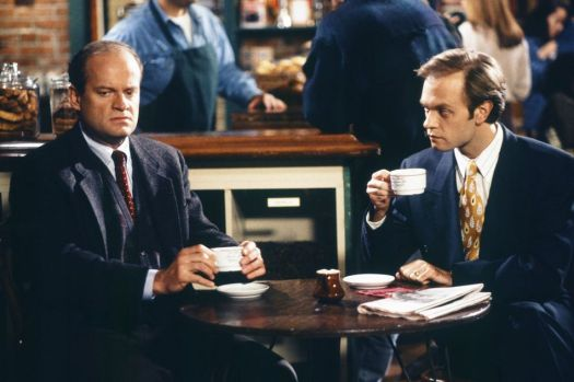 Frasier (Kelsey Grammar) and Niles (David Hyde Pierce) enjoy a quiet cup of coffee while definitely not being annoyed about anything.