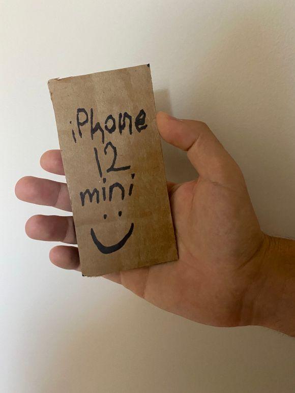 iPhone 12 mini in macho man hands.