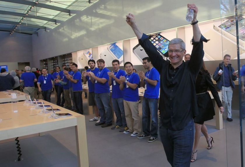 Tim Cook, celebrating his innovation of widening the iPhone consumer pool into two price points.