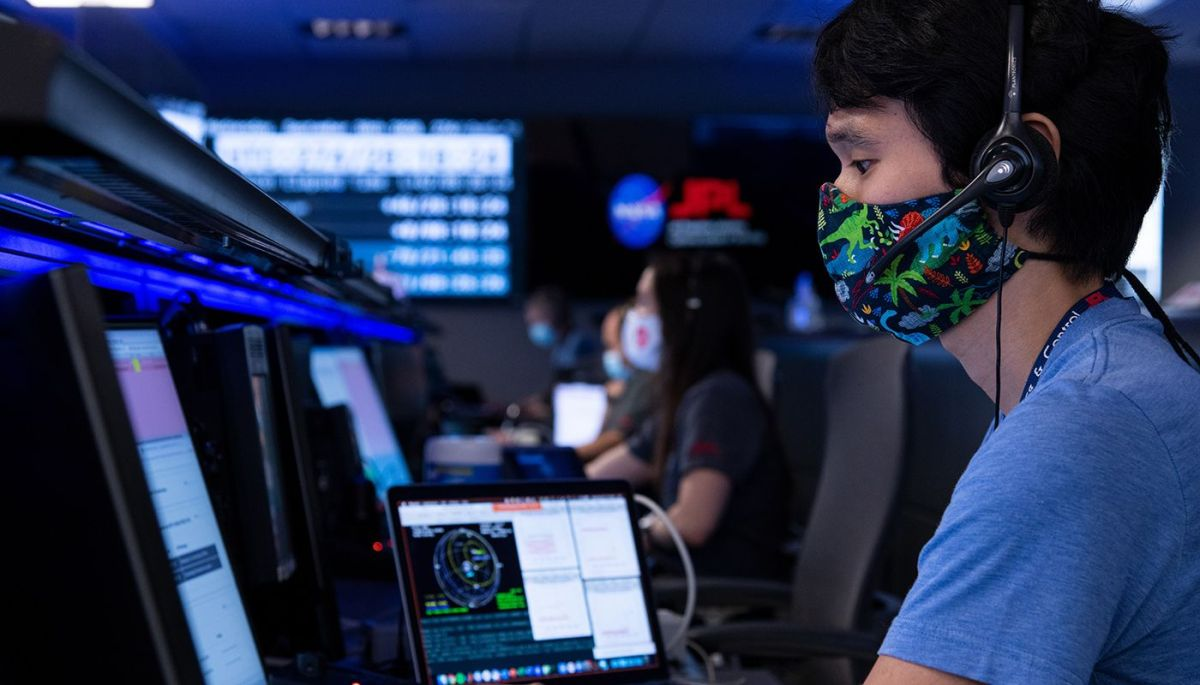 NASA Attitude Control Systems lead Chris Pong wears a mask while the mission to Mars continuesduring the COVID-19 pandemic.