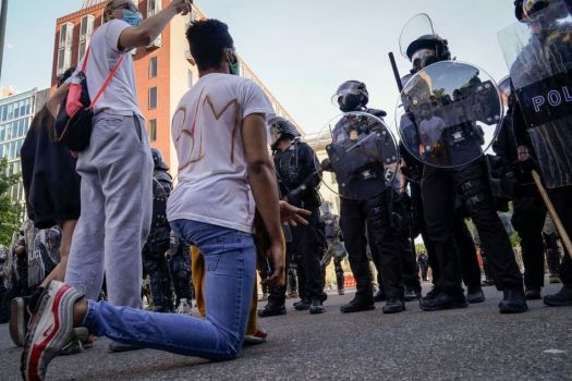 JUNE 1, 2020: Demonstrators confront law enforcement during an anti-police brutality protest in downtown Washington, D.C.