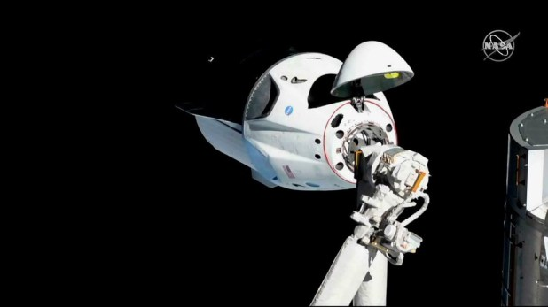 A SpaceX Crew Dragon is near the Harmony module of the International Space Station in March 2019.