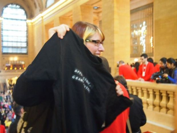 """The first shoppers to enter the store were awarded with a black shirt that read """"Apple Store Grand Central,"""" in a style that resembles a train schedule ticker."""