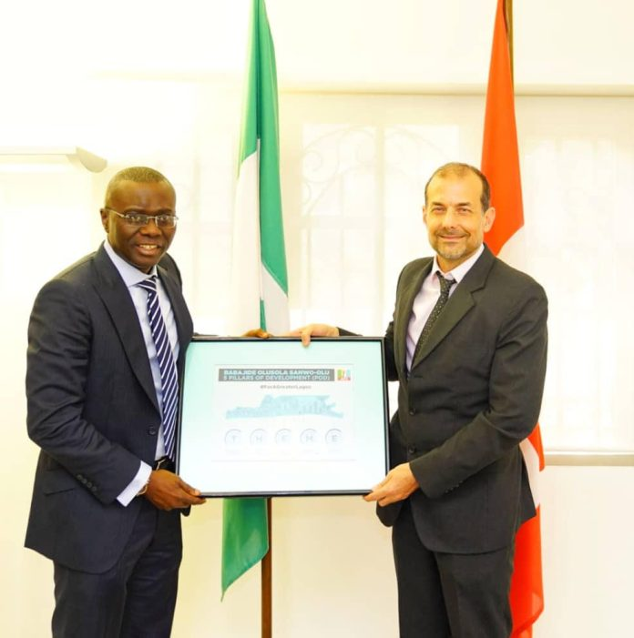 Mr. Babajide Sanwo-Olu presents his THEME development agenda to the Switzerland Ambassador Nigeria, Mr. George Steiner at the Swiss Embassy in Abuja during a strategic engagement on Wednesday.