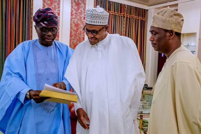 President Mohammadu Buhari (middle) flanked by Lagos State Governor-elect, Mr. Babajide Sanwo-Olu (left) and his Deputy Governor-elect, Dr. Obafemi Hamzat, during a courtesy call on the president by the later, in Aso Rock Villa, Abuja.
