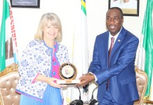 Lagos State Deputy Governor, Dr. Obafemi Hamzat pressing a souvenir to the United Kingdom Minister of State for Africa at the Foreign Commonwealth Office and Minister of State for Department of International Development, Rt. Hon. Harnett Baldwin during the courtesy visit to the Office of the Deputy Governor on Tuesday.