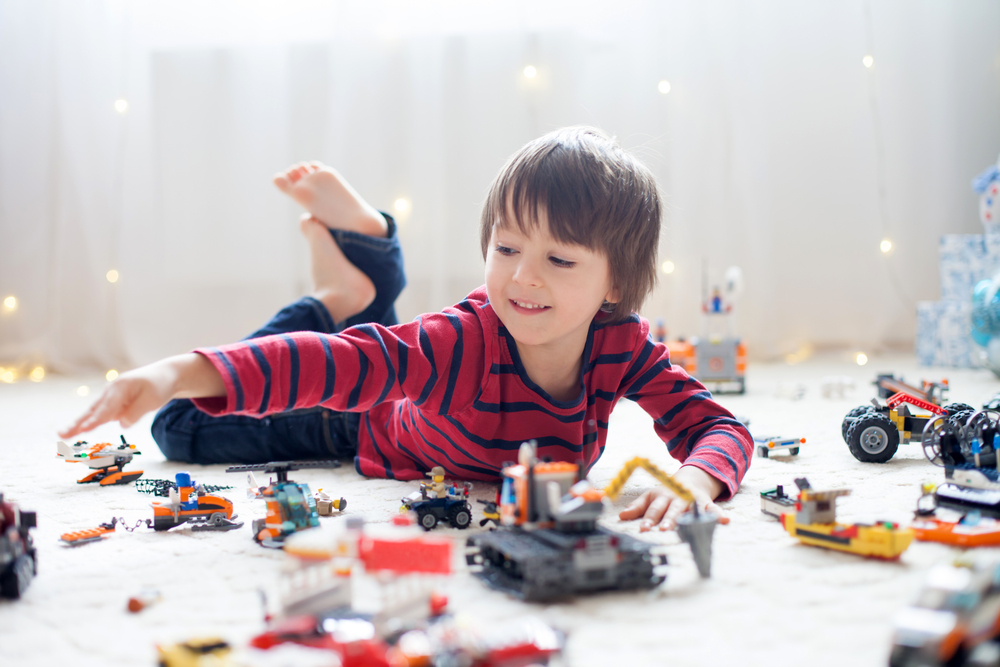 Boy plays with LEGO cheap