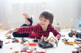 Boy plays with LEGO bricks