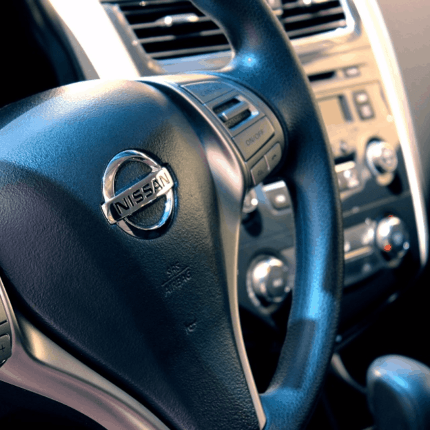 Image showing a car steering wheel with Nissan logo