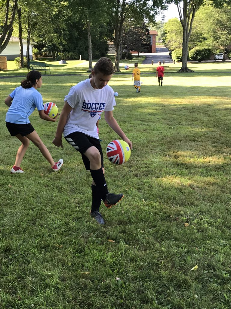 3 Things Your Kid Will Learn at Soccer Camp. British Soccer Camp with Challenger Sports will help your child develop soccer footskills, passing and learn some fun soccer tricks! #challengersports #soccer #soccercamp #britishsoccercamp #footskills #soccertricks
