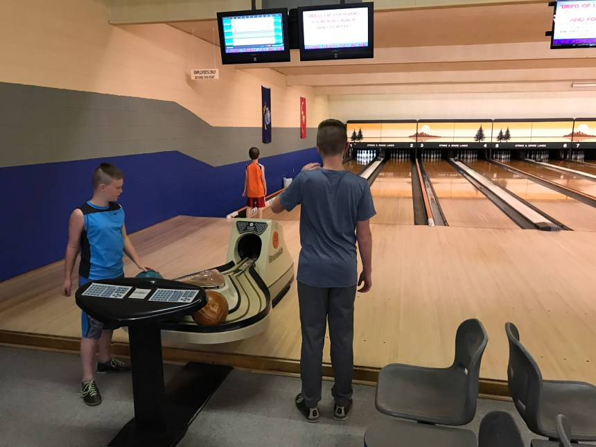 Taking the kids bowling is a fun and cheap staycation idea! #staycationidea #kidsbowlfree #kidsactivities #familyfun
